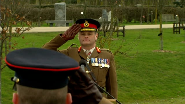 commemorative stones for commonwealth recipients of the victoria cross unveiled major general robert nitsch saluting during silence / people in... - the victoria cross stock-videos und b-roll-filmmaterial