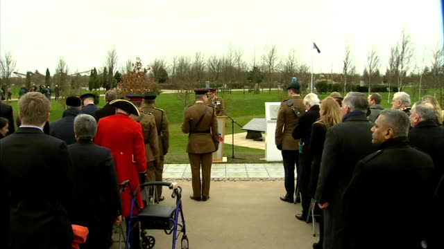 commemorative stones for commonwealth recipients of the victoria cross unveiled **music heard intermittently sot** trumpet playing during ceremony... - the victoria cross stock-videos und b-roll-filmmaterial