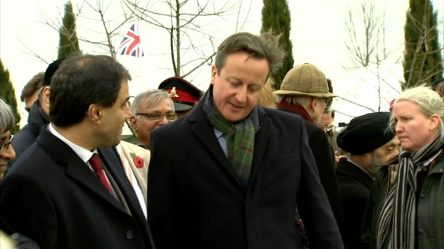 commemorative stones for commonwealth recipients of the victoria cross unveiled david cameron chatting to people and looking at wreaths / cameron... - the victoria cross stock-videos und b-roll-filmmaterial