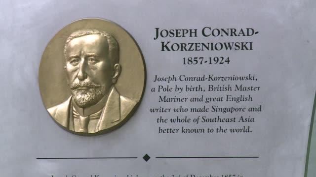 commemorative tablet to joseph conrad in singapore - english language stock videos & royalty-free footage
