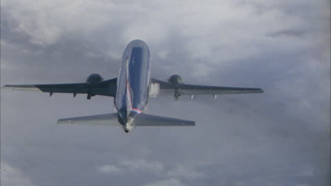ws pov commercial aircraft flying over clouds - float stock videos & royalty-free footage