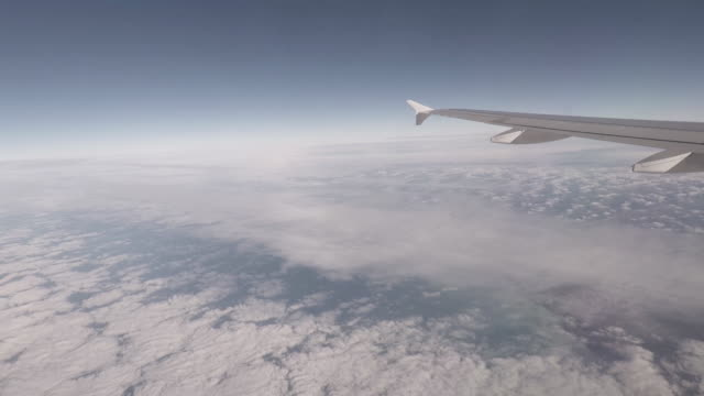 commercial aircraft in flight above clouds, france, europe - aircraft wing stock videos & royalty-free footage