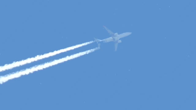 commercial airplane flying in sky - vapour trail stock videos & royalty-free footage