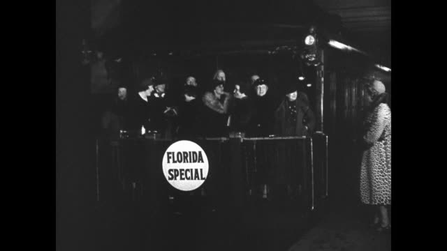 traveling commercial airplane in flight people in winter coats walking into train station boarding 'florida special' train intertitle 'for... - 1937 stock videos and b-roll footage
