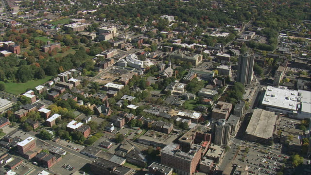 aerial commercial and industrial area, with some new buildings amongst older, overgrown ones / springfield, massachusetts, united states - springfield massachusetts stock videos & royalty-free footage