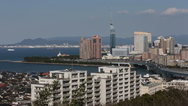 commercial and residential buildings stand in fukuoka city fukuoka prefecture japan on friday march 3 the fukuoka tower center left stands among... - general view stock videos & royalty-free footage