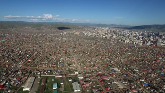 vídeos de stock e filmes b-roll de commercial and residential buildings stand in this aerial video above ulaanbaatar mongolia on saturday aug 8 people ascends stairs at the zaisan... - ulan bator