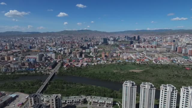 vídeos de stock e filmes b-roll de commercial and residential buildings stand in this aerial video above ulaanbaatar mongolia on saturday aug 8 2015 - ulan bator