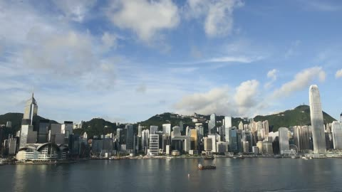 commercial and residential buildings standing on hong kong island are seen from the tsim sha tsui district of hong kong, china, on saturday, june 20... - hong kong island stock videos & royalty-free footage