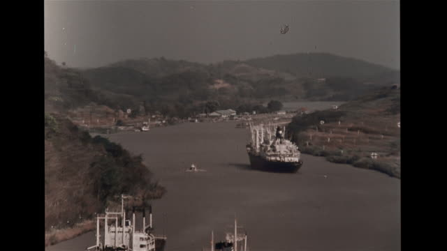 commercial boats on rio chagres river ms ship moving across body of water ms lykes lines cargo ship moving across lake gatun motorboat fg shipping... - panama canal stock videos & royalty-free footage