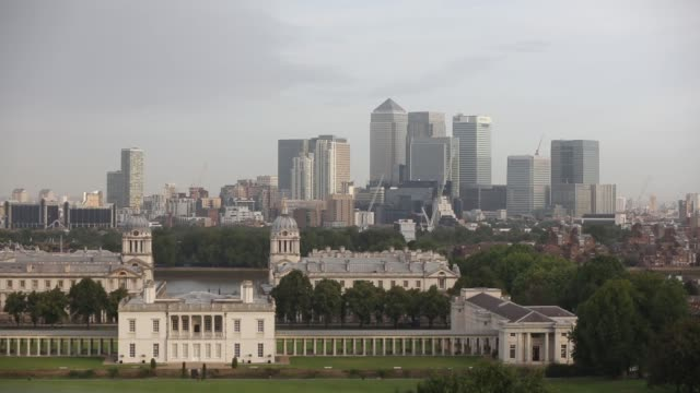 commercial buildings and skyscrapers of the canary wharf business and shopping district top stands beyond the old royal naval college at greenwich in... - royal navy college greenwich stock videos & royalty-free footage