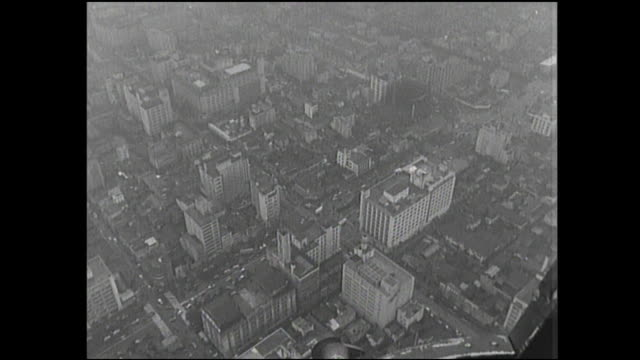 commercial buildings line streets in the ginza. - black and white点の映像素材/bロール