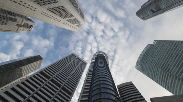 commercial buildings with clouds tilt up time lapse
