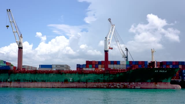 commercial dock loading shipping containers, zanzibar, africa - unloading stock videos & royalty-free footage