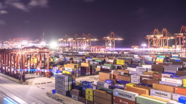 commercial dock with cargo containers in Shanghai in cloud sky at night . time lapse 4k