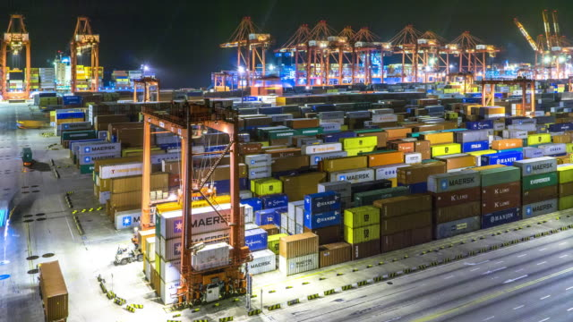 commercial dock with cargo containers . time lapse 4k