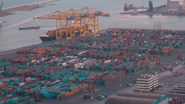 vídeos de stock e filmes b-roll de commercial dock with containers and cranes - porto de barcelona