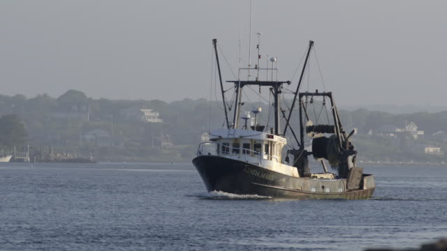 commercial fishing boat heading out to sea from a small new england fishing village - front view as boat comes towards camera - 2 - eastern usa stock videos & royalty-free footage