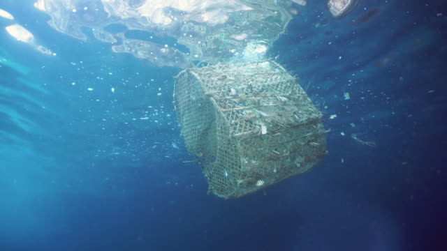 commercial fishing industry pollution in the sea southeast asia - rete da pesca commerciale video stock e b–roll