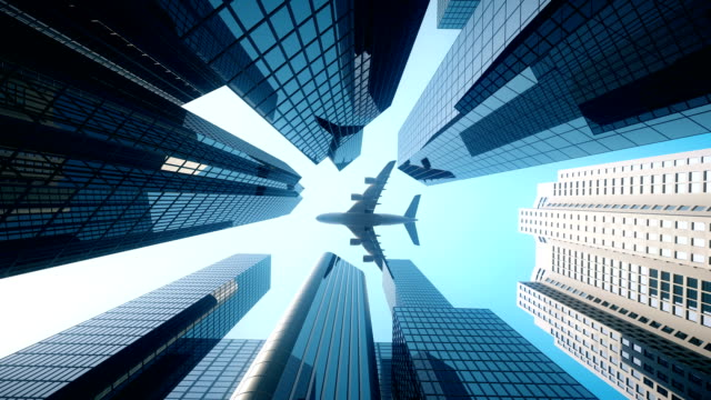 commercial flight over business district - blue - mezzo di trasporto video stock e b–roll