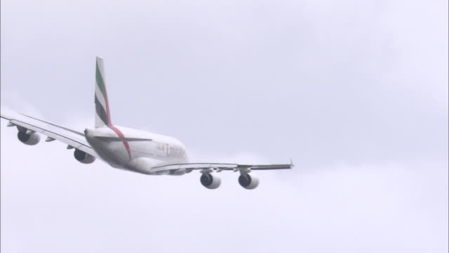 ms commercial jet flying against sky, heathrow airport, london, united kingdom - airbus stock-videos und b-roll-filmmaterial
