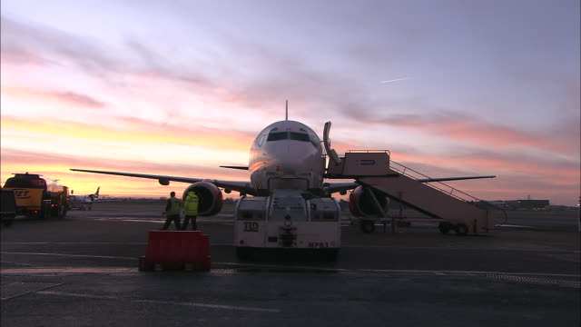 ws commercial jet on tarmac at dawn, belfast airport, ireland, united kingdom - belfast stock videos & royalty-free footage