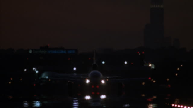 cu commercial jet taking off at night, silhouette of empire state building in background, jfk airport, new york city, new york, usa - kennedy airport stock videos & royalty-free footage