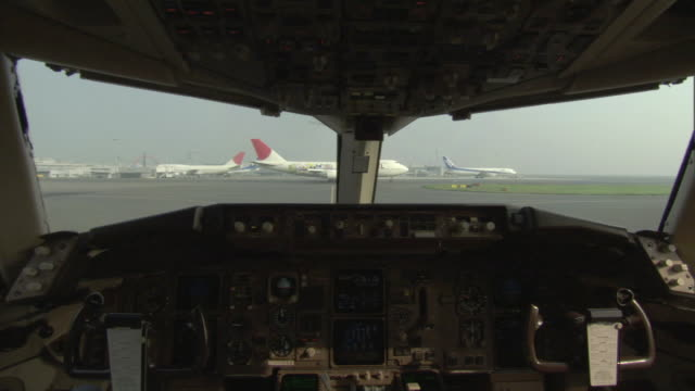 POV Commercial jet taxiing on runway seen from cockpit of plane / Tokyo, Tokyo Prefecture, Japan