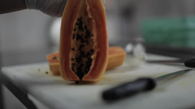 Commercial Kitchen Food Preparation - Cutting Papaya