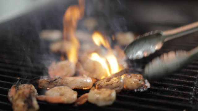 commercial kitchen food preparation - grilling shrimp - metal grate stock videos & royalty-free footage