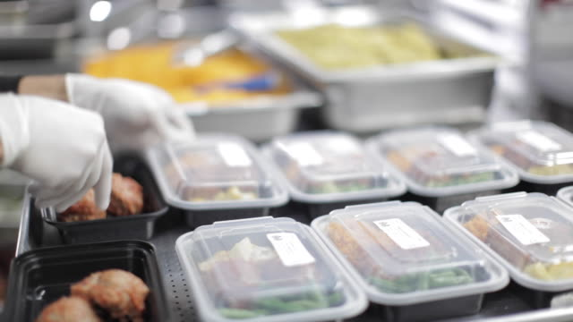 commercial kitchen food preparation - prepared meals - nutritionist stock videos and b-roll footage