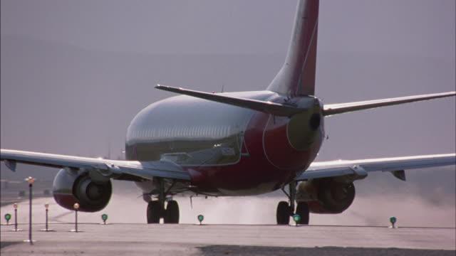 stockvideo's en b-roll-footage met commercial planes speed down the runway as they take off. - start  en landingsbaan