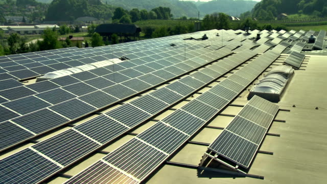aerial commercial solar panels - solar power station stock videos and b-roll footage