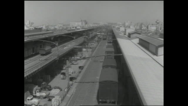 commercial trucks transport cargo on the street adjacent to the freight depot at the akihabara railway station. - akihabara station stock videos and b-roll footage