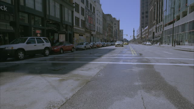 commercial vehicles move along euclid avenue in downtown cleveland. - armored truck stock videos and b-roll footage