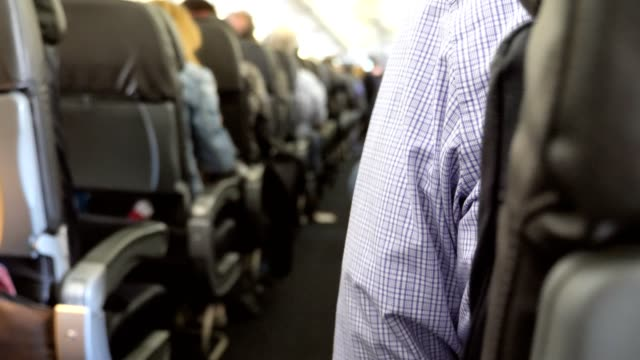 commerical airplane filled with passengers - economy class stock videos & royalty-free footage