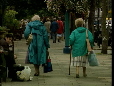 Commission urges people to have more babies ITN LIB FROM SERVER Elderly women away down street Pensioner playing bingo Pensioner along with zimmer