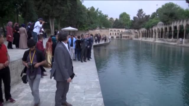commissioner for european neighbourhood policy and enlargement negotiations johannes hahn visits the fish lake in sanliurfa turkey on april 26 2016... - europäische kommission stock-videos und b-roll-filmmaterial