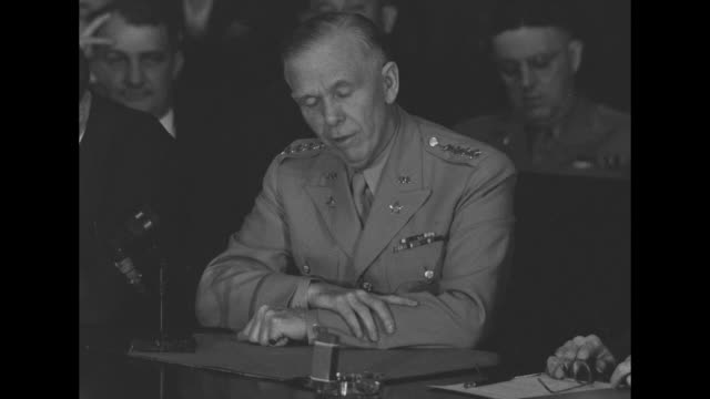 stockvideo's en b-roll-footage met committee members seated around table listening to george marshall us army chief of staff speaking / cu senator burton wheeler listening / committee... - geallieerde mogendheden