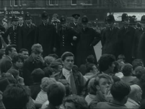 committee of 100 anti-nuclear demonstration; neg section: england: london: trafalgar square: line of police on the terrace of the square: sightseers... - binoculars stock videos & royalty-free footage