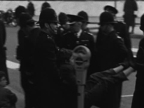 committee of 100 demonstrations; england: london: grosvenor square: us embassy: police carrying people away: more being carried off: neg: 16mm: itn :... - itv evening bulletin stock videos & royalty-free footage