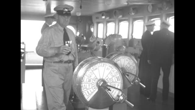 commodore harry manning at the wheel of the ss united states and officers in the ship's wheelhouse / a uniformed man places a glass of water on the... - graph paper stock videos & royalty-free footage
