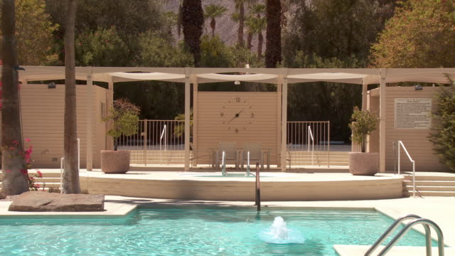 zo ws common area swimming pool at mid-century modern racquet club garden villas residential community - pool stock videos & royalty-free footage