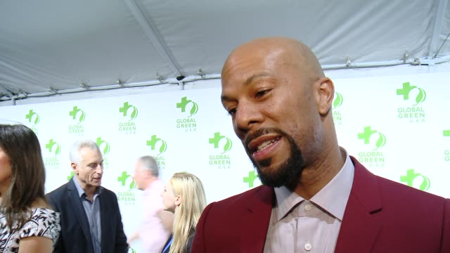 vídeos de stock, filmes e b-roll de interview common on making the planet greener and on the upcoming academy awards at the global green usa 12th annual preoscar® party avalon on... - oscar party
