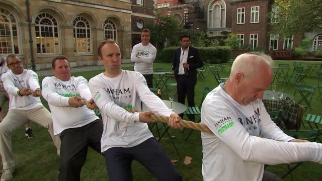 Commons vs Lords tug of war ENGLAND London Westminster EXT Various of 'Commons vs Lords' tug of war event participants including Matt Hancock MP...