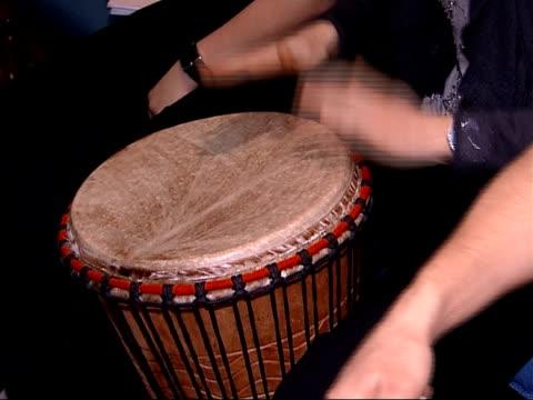 Shilpa Shetty to speak Choir rehearsing song SOT Bongo drum being played Choir members singing PAN Back View Clarinetist playing