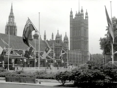 commonwealth flags gently sway in front of the houses of parliament - british empire stock videos & royalty-free footage