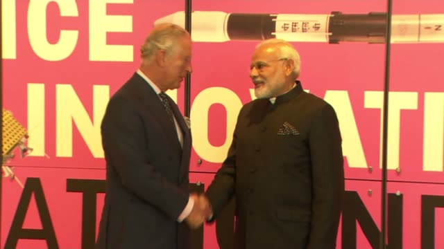 stockvideo's en b-roll-footage met prince charles meets indian pm modi england london kensington ext prince charles prince of wales from car and greeted on arrival at the science... - britse rijk