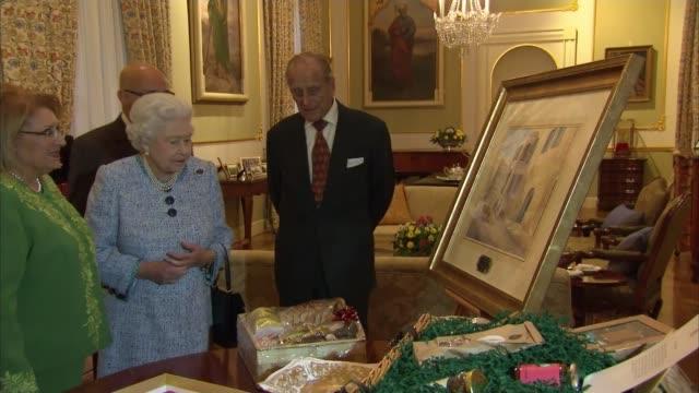Queen Elizabeth speech EXT GV Villa Guardamangia / Queen Elizabeth and Prince Philip looking at painitng of Villa Guardamangia Prince Philip comments...