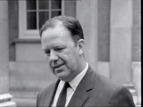 """stockvideo's en b-roll-footage met commonwealth prime ministers' conference: mr arnold smith interview; england: london: marlborough house: ext arnold smith : sof: - . """"well, i think... - itv evening bulletin"""